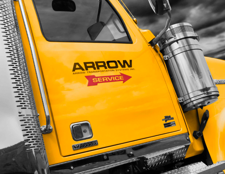 Large yellow truck with Arrow logo